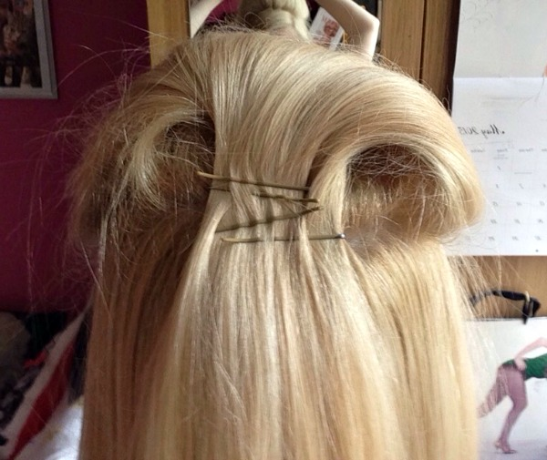 Push the hair forward and then clip it in place with bobby pins.